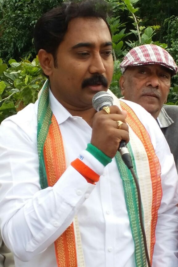 Sri Umesh Kabbal, BJP Youth leader speaking to people gathered for the event